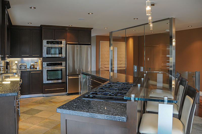 Modern kitchen with glass feature wall resized