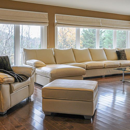 Living room with cream coloured couches-resized