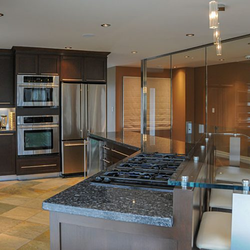 Modern kitchen with glass feature wall-resized
